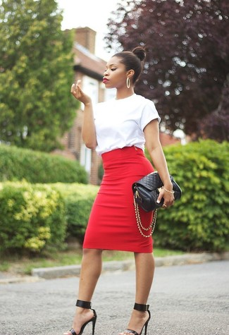A white crew-neck t-shirt and a red pencil skirt are a great outfit formula to have in your arsenal. Elevate this ensemble with black leather heeled sandals.