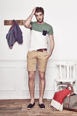 A white crew-neck t-shirt and tan shorts feel perfectly suited for weekend activities of all kinds. A cool pair of navy canvas espadrilles is an easy way to upgrade your look. This getup is the definition of perfect for boiling hot warm weather afternoons.