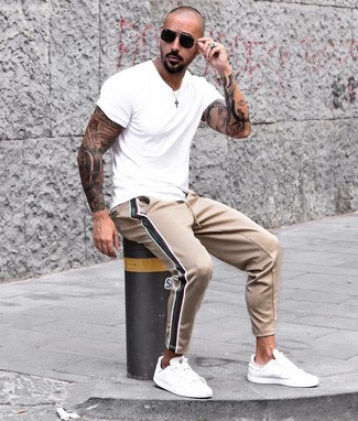 How to wear: white crew-neck t-shirt, tan sweatpants, white leather low top sneakers, black sunglasses