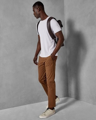 Tobacco Chinos Outfits: If you're looking to take your casual style game to a new level, team a white crew-neck t-shirt with tobacco chinos. Let your expert styling really shine by finishing off your look with a pair of beige leather low top sneakers.