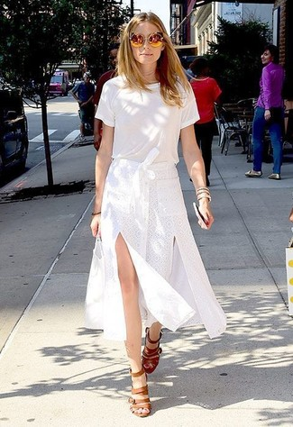 Olivia Palermo wearing White Crew-neck T-shirt, White Slit Midi Skirt, Tan Leather Heeled Sandals, Gold Sunglasses