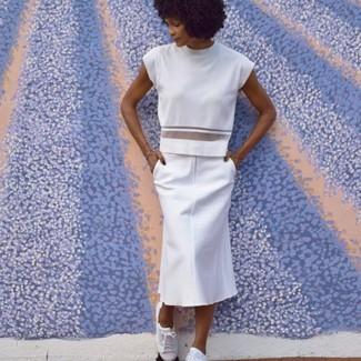 How to wear: white crew-neck t-shirt, white midi skirt, white low top sneakers
