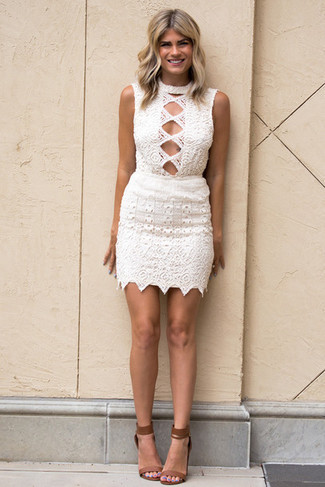 Brown Leather Heeled Sandals Outfits: Perfect the casually stylish ensemble in a white crochet bodycon dress. In the footwear department, go for something on the smarter end of the spectrum with a pair of brown leather heeled sandals.