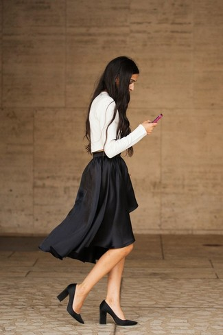 Go for a white cropped sweater and a black pleated midi skirt for a standout ensemble. Black satin pumps will add elegance to an otherwise simple look. This is a tested option for a comfortable transition outfit.