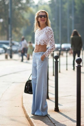 A white lace cropped sweater and light blue wide leg pants is a nice combination to add to your styling repertoire. We promise this getup is the answer to all of your transitional style struggles.
