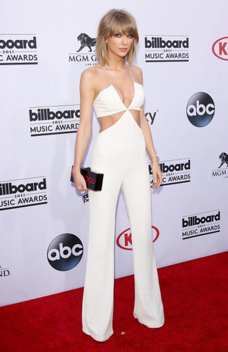 Taylor Swift wearing White Cutout Jumpsuit, Black Print Clutch