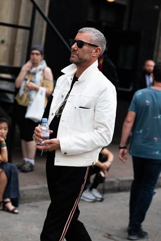 How to wear: white denim jacket, black crew-neck t-shirt, black vertical striped sweatpants, black sunglasses