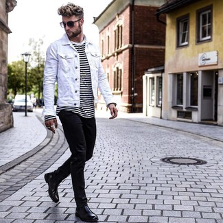 How to Wear a White and Black Horizontal Striped Crew-neck T-shirt For Men: A white and black horizontal striped crew-neck t-shirt and black skinny jeans worn together are a perfect match. Add black leather chelsea boots to the equation to instantly dial up the classy factor of your getup.