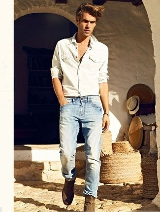 A white denim shirt and light blue jeans is a wonderful combination worth integrating into your wardrobe. Channel your inner Ryan Gosling and grab a pair of brown suede chelsea boots to class up your look.