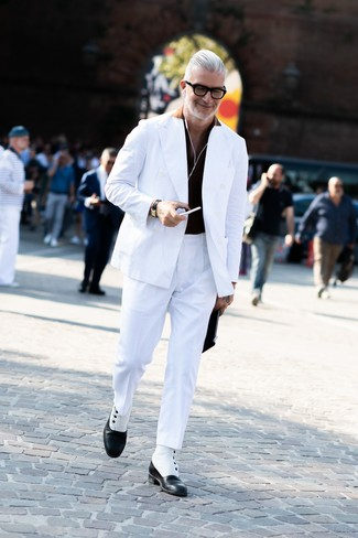 How to wear: white double breasted blazer, black polo, white dress pants, black and white leather dress boots