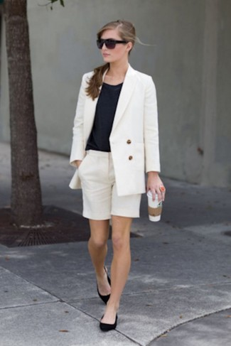 Opt for a white double breasted blazer and a white bermuda shorts for a sleek elegant look. A pair of Aquazzura Belgravia Lattice Suede Flat Black brings the dressed-down touch to the getup. We guarantee this getup is the answer to all of your transitional style problems.