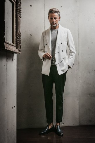 How to wear: white double breasted blazer, grey crew-neck sweater, dark green dress pants, dark green leather loafers