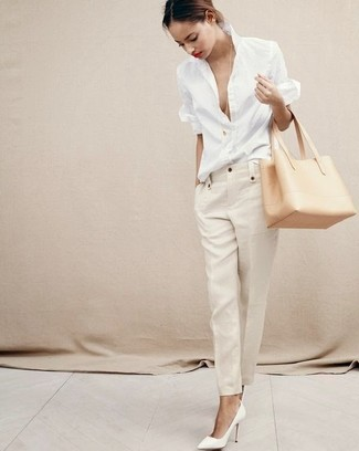 Make people go weak in their knees by slipping into a white linen dress shirt and a tan leather tote bag. White leather pumps complement this ensemble very nicely. A look like this is perfect for winter-to-spring weather.