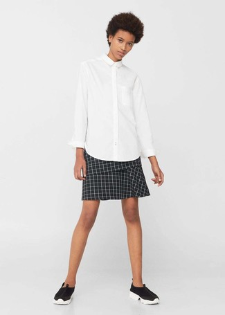 A white button shirt and a black and white check mini skirt is a smart combination worth integrating into your wardrobe. A pair of black running shoes will be a stylish addition to your outfit.
