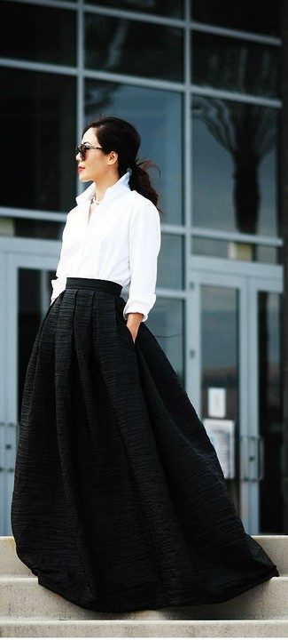 If you like the comfort look, consider wearing a white dress shirt and a black maxi skirt. Mastering springtime fashion is easy with style inspo like this.