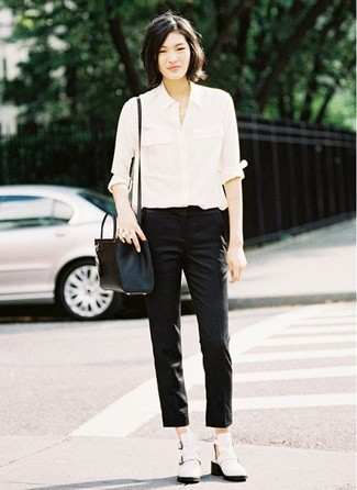 How to wear: white dress shirt, black skinny pants, white cutout leather ankle boots, black leather crossbody bag