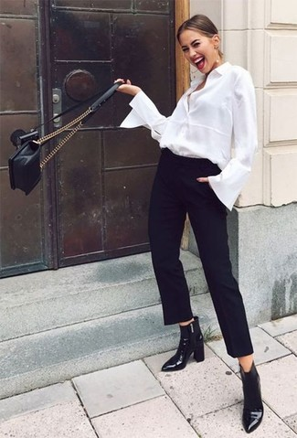 Women's Looks & Outfits: What To Wear In 2020: Try pairing a white dress shirt with black tapered pants for a sleek refined look. Our favorite of a ton of ways to complement this ensemble is with black leather ankle boots.