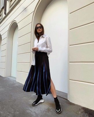 How to wear: white dress shirt, black vertical striped midi skirt, black and white athletic shoes