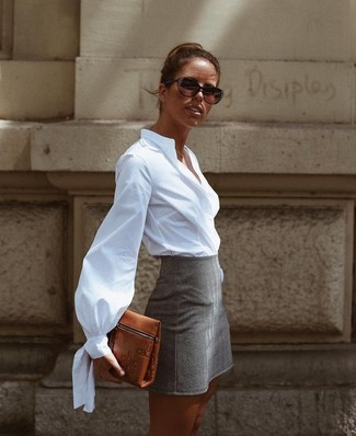 Consider pairing a white oxford shirt with a grey mini skirt for a Sunday lunch with friends. This combo is a great pick come warmer weather.