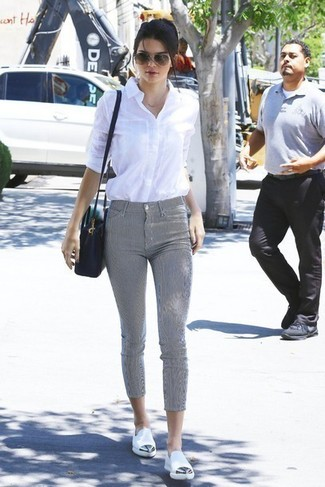 Kendall Jenner wearing White Dress Shirt, Grey Skinny Pants, White Leather Loafers, Black Leather Crossbody Bag