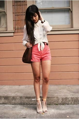 Hot Pink Shorts Outfits For Women: This combo of a white dress shirt and hot pink shorts makes for the ultimate cool-girl's relaxed look. A pair of beige cutout leather ankle boots rounds off this outfit quite well.