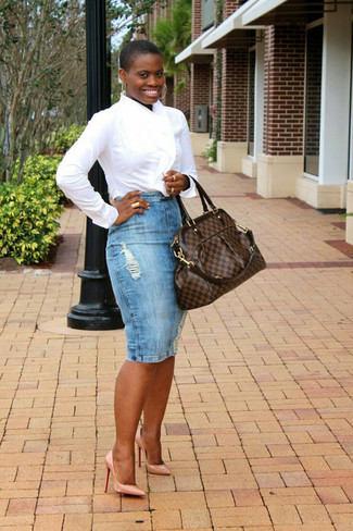 How to Wear a Light Blue Denim Pencil Skirt: This combination of a white dress shirt and a light blue denim pencil skirt is a solid bet when you need to look uber chic and refined. Our favorite of a myriad of ways to round off this ensemble is beige leather pumps.