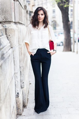 How to wear: white silk dress shirt, navy flare pants, black leather pumps, red leather satchel bag