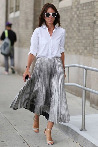 This pairing of a white dress shirt and a silver pleated midi skirt is perfect for a night out or smart-casual occasions. For shoes, opt for a pair of silver leather heeled sandals. You'll love to work this combo throughout the summer.