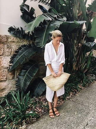 Tan Straw Tote Bag Outfits: Such staples as a white linen dress shirt and a tan straw tote bag are an easy way to introduce some cool into your casual styling rotation. Send an otherwise dressy look in a less formal direction by wearing brown leather flat sandals.