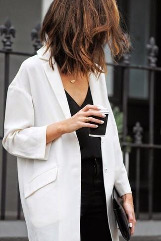 How to wear: white duster coat, black silk tank, black skinny pants, black leather clutch