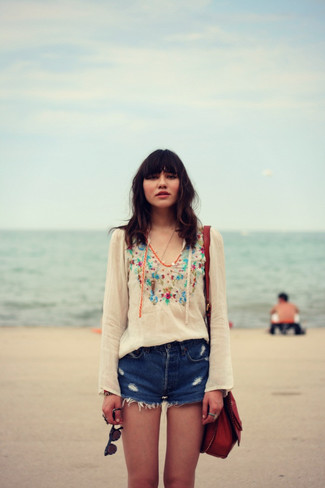 How to wear: white embroidered peasant blouse, blue ripped denim shorts, burgundy leather crossbody bag
