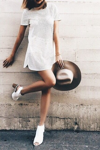 How to wear: white eyelet shift dress, white cutout leather ankle boots, brown wool hat