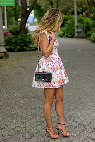 White Floral Skater Dress Outfits: This outfit with a white floral skater dress isn't hard to pull off and leaves room to more sartorial experimentation. Feeling venturesome? Change things up a bit by finishing off with a pair of orange suede heeled sandals.