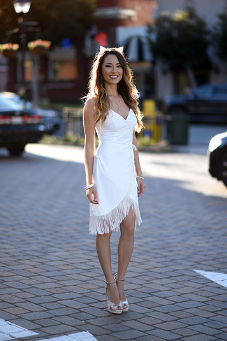 A white fringe sheath dress and a headband is a great combination to impress your crush on a date night. Balance this outfit with white leather heeled sandals. This combo is also perfect if you're scouting for warm weather wear to make a tedious day in the office more bearable.