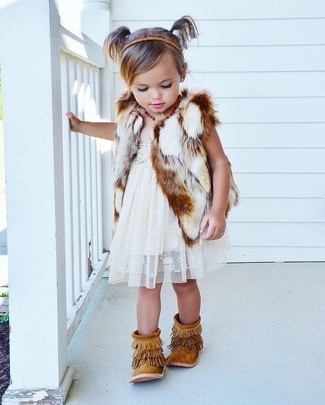How to wear: white fur vest, white lace dress, tan fringe suede boots