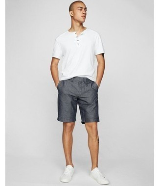 How to Wear a White Henley Shirt For Men: The formula for relaxed casual style? A white henley shirt with charcoal shorts. On the footwear front, this look pairs perfectly with white leather low top sneakers.
