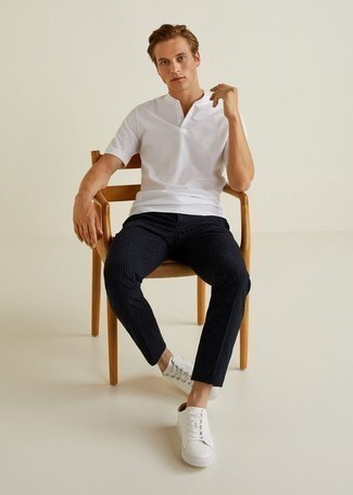 How to Wear Navy Vertical Striped Chinos: A white henley shirt and navy vertical striped chinos are indispensable menswear items, without which no wardrobe would be complete. For extra fashion points, grab a pair of white leather low top sneakers.