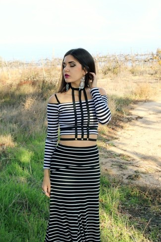 Wear a white horizontal striped cropped top with a black striped maxi skirt for a Sunday lunch with friends.