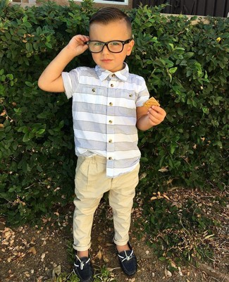 How to Wear a White Horizontal Striped Short Sleeve Shirt For Boys: Suggest that your tot pair a white horizontal striped short sleeve shirt with tan trousers to help him look like a true little gent. This outfit is complemented well with black boat shoes.