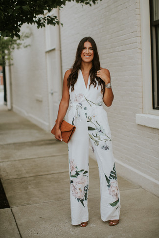 Brown Leather Heeled Sandals Outfits: Wear a white floral jumpsuit to pull together a casual and practical outfit. Want to go all out on the shoe front? Complete your outfit with brown leather heeled sandals.