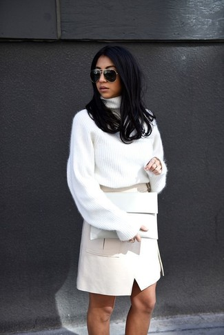 A smart casual pairing of a white knit turtleneck and an Asos Collection Leather Look Pencil Skirt With Utility Pockets can maintain its relevance in many different circumstances. A look like this is perfect for transeasonal weather.
