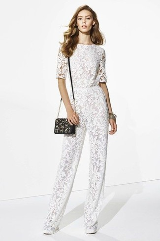 How to wear: white lace jumpsuit, black embellished leather crossbody bag, gold bracelet
