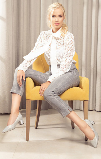 Plaid Pants Outfits For Women: Why not pair a white lace long sleeve blouse with plaid pants? Both of these items are super comfy and will look great matched together. Wondering how to round off? Add silver leather pumps to the mix to step up the glamour factor.