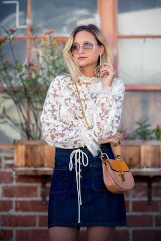 How to wear: white lace long sleeve blouse, navy denim mini skirt, tan leather crossbody bag