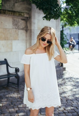 Step up your off-duty look in a white lace swing dress.