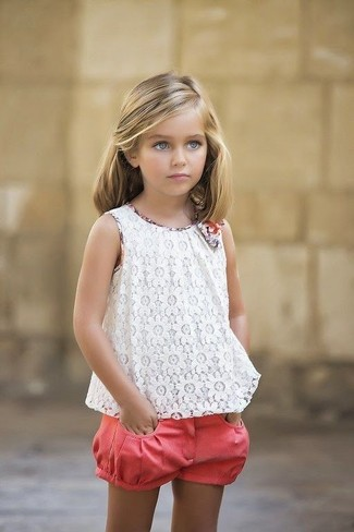How to Wear Pink Shorts For Girls: Suggest that your kid opt for a white lace tank top and pink shorts for a laid-back yet fashion-forward outfit.