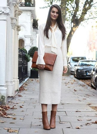 How to wear: white long sleeve blouse, beige knit pencil skirt, brown leather ankle boots, brown leather clutch