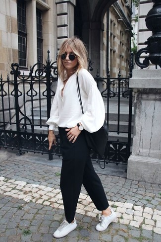 How to wear: white silk long sleeve blouse, black chinos, white leather low top sneakers, black nylon crossbody bag