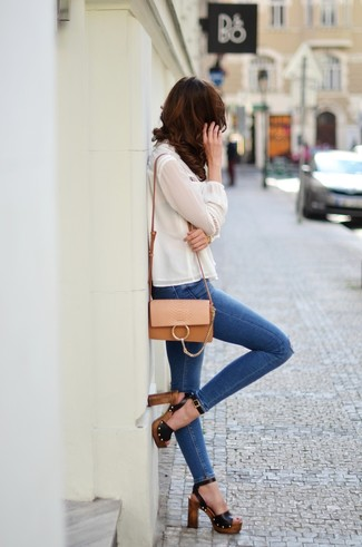 How to wear: white silk long sleeve blouse, blue ripped skinny jeans, black leather heeled sandals, tan leather crossbody bag