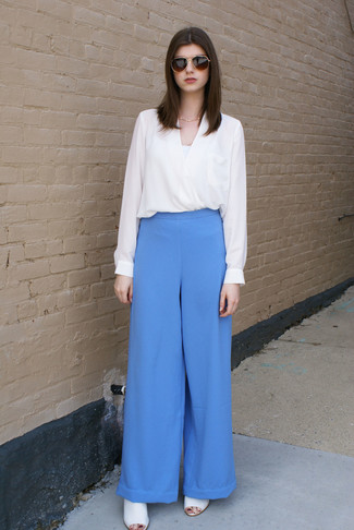 A white long sleeve blouse and 3.1 Phillip Lim High Waist Wide Leg Trousers are absolute must-haves if you're figuring out a smart casual wardrobe that matches up to the highest style standards. White leather mules will become an ideal companion to your style. Entirely appropriate for hot weather, you can rock this ensemble all season long.